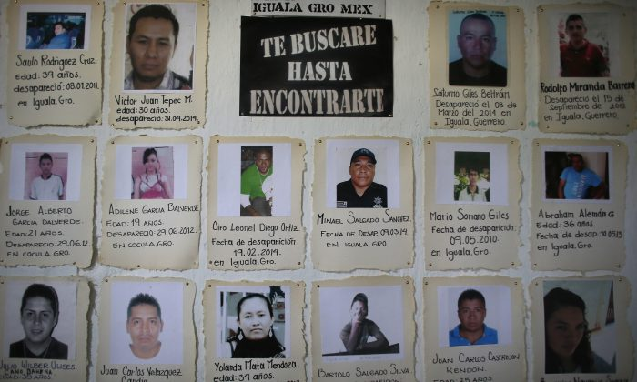 In this April 21, 2015 photo, snapshots with brief descriptions of missing people are tacked to a board in the San Gerardo Catholic Parish in Iguala, Mexico. (AP Photo/Dario Lopez-Mills)