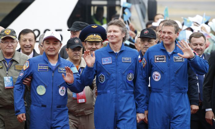 (L–R) Kazakhstan's Aidyn Aimbetov, Russia's Gennady Padalka and Denmark's Andreas Mogensen at a welcoming ceremony in Kazakhstan's capital Astana on Sept. 12, 2015. Russian Soyuz TMA-16M capsule landed safely in Kazakhstan, bringing home a three-person crew from the International Space Station, including a record-breaking Russian cosmonaut. (Yuri Kochetkov/Pool Photo via AP)