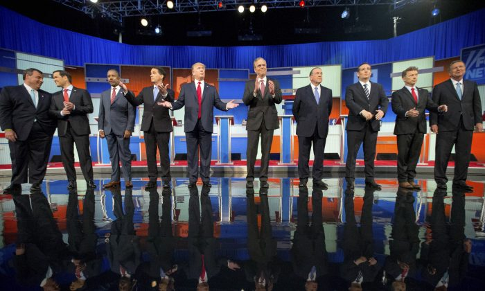 Republican presidential candidates from left, Chris Christie, Marco Rubio, Ben Carson, Scott Walker, Donald Trump, Jeb Bush, Mike Huckabee, Ted Cruz, Rand Paul, and John Kasich take the stage for the first Republican presidential debate in Cleveland on Aug. 6. (AP Photo/Andrew Harnik, File)