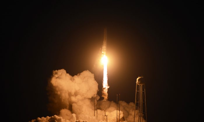 FILE - In this Tuesday, Oct. 28, 2014 file photo, an unmanned Orbital Sciences Corp.'s Antares rocket headed for the International Space Station lifts off from the Wallops Flight Facility on Wallops Island, Va. shortly before exploding. On Thursday, Sept. 17, 2015, NASA's inspector general said that Orbital Sciences Corp. faces significant risks in its effort to recover from the explosion. (AP Photo/Eastern Shore News, Jay Diem)