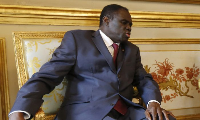 In this June 1,  2015 photo, Burkina Faso's transitional president Michel Kafando meets with French president Francois Hollande at the Elysee Palace in Paris, France. (Ian Langsdon/Pool Photo via AP)