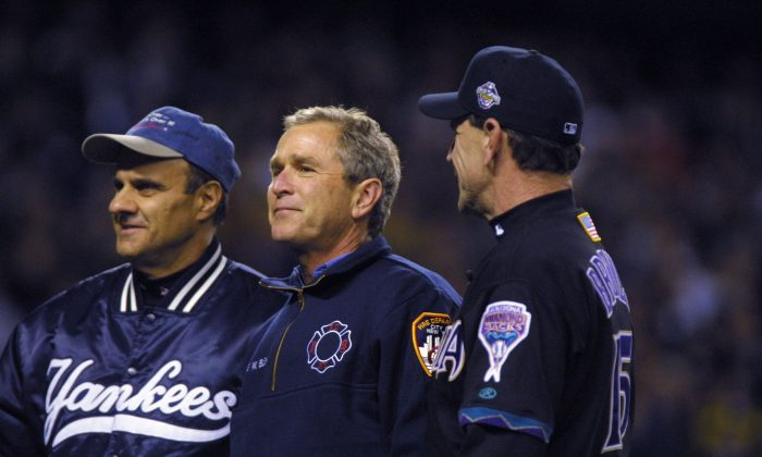President George W. Bush talks with managers Joe Torre #6 of the New York Yankees and Bob Brenly #15 of the Arizona Diamondbacks before game 3 of the World Series at Yankee Stadium in New York, New York. Yankees win, 2-1 over the Diamondbacks. (Al Bello/ALLSPORT)