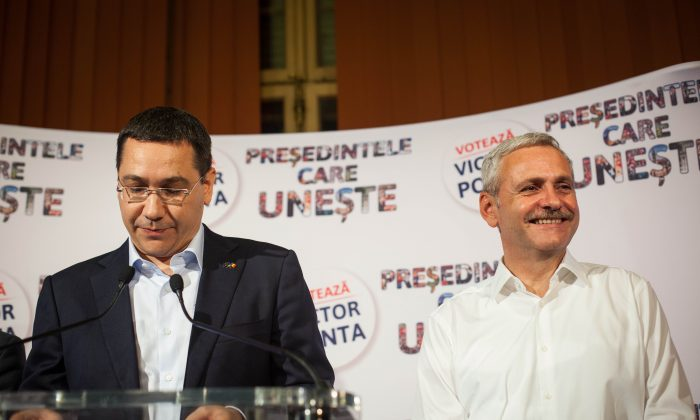Romanian Prime Minister and presidential candidate Victor Ponta (L) addresses the media, along with the number two of his social democratic party Liviu Dragnea, after seeing the exit poll results in the first round of presidential elections, in Bucharest, on Nov. 2, 2014. (Andrei Pungovschi/AFP/Getty Images)