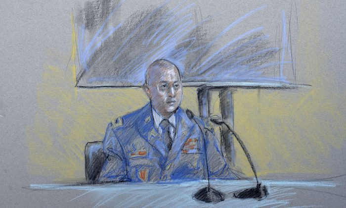 Maj. Silvino Silvino, Sgt. Bowe Bergdahl's company commander, is questioned during a preliminary hearing to determine if Sgt. Bergdahl should face a court-martial Thursday, Sept. 17, 2015, at Fort Sam Houston in San Antonio. (Brigitte Woosley via AP)