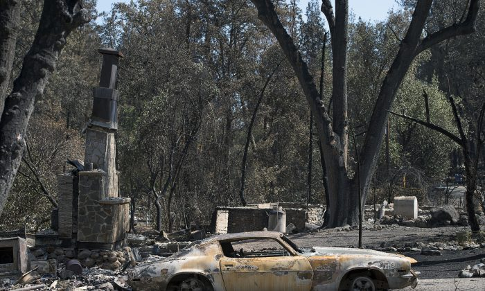 Scorched trees and burned vehicles and the remains of homes cover the landscape Thursday Sept. 17, 2015, in Anderson Springs, Calif. The Valley fire that sped through Middletown and other parts of rural Lake County, less than 100 miles north of San Francisco, has continued to burn since Saturday despite a massive firefighting effort. (Paul Kitagaki Jr./The Sacramento Bee via AP)  MAGS OUT; LOCAL TELEVISION OUT (KCRA3, KXTV10, KOVR13, KUVS19, KMAZ31, KTXL40); MANDATORY CREDIT  (REV-SHARE) (ONLN OUT; IONLN OUT - MBI)