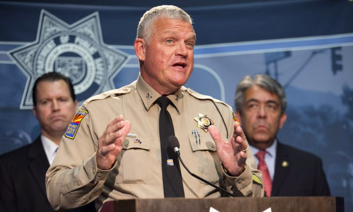 Colonel Frank Milstead, Director of the Department of Public Safety speaks during a press conference to announce the arrest of a suspect in the Phoenix freeway shootings, at DPS headquarters in Phoenix on Friday, Sept. 18, 2015.  (David Wallace/The Arizona Republic via AP)