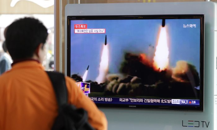 A Man watchs a TV broadcast reporting the North Korean missile launch at the Seoul Railway Station, in Seoul, South Korea, on March 26, 2014. (Chung Sung-Jun/Getty Images)