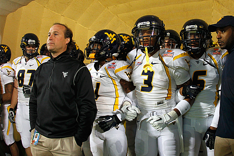 Dana Holgorsen's (left in jacket) Mountaineers will compete in the Big 12 in 2012. (Mike Ehrmann/Getty Images)