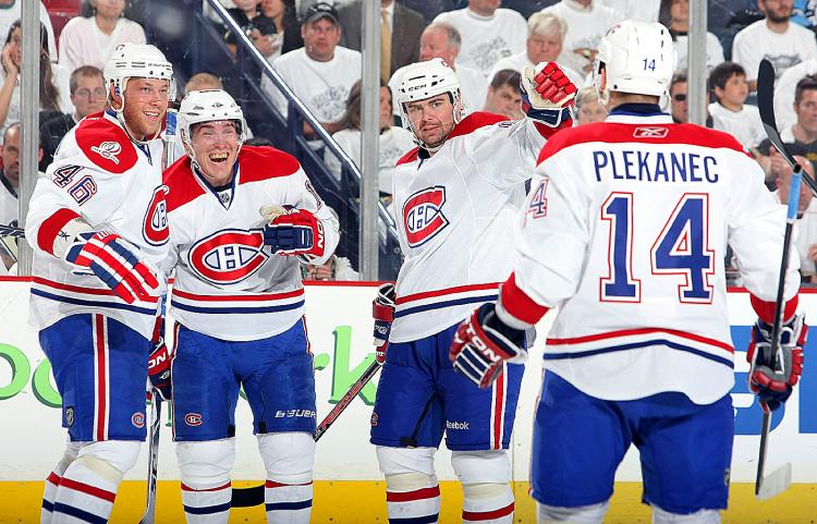 MONTREAL MOVES ON: Michael Cammalleri (second from left) celebrates the game-winning goal. (Dave Sandford/Getty Images)
