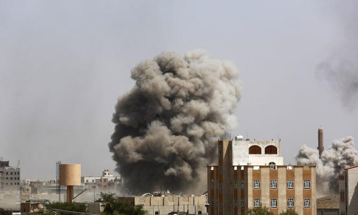 Smoke rises after a Saudi-led airstrike hits an army academy in Sanaa, Yemen, Sunday, Sept. 20, 2015. (AP Photo/Hani Mohammed)