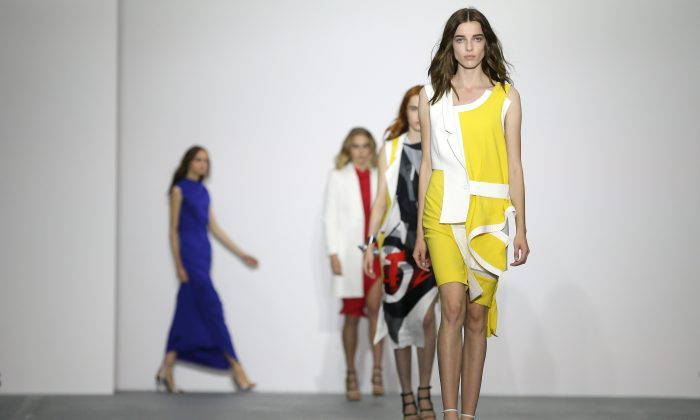 Models wear outfits by designer Jean-Pierre Braganza during the Spring/Summer 2016 show for London Fashion Week at Brewer Street Car Park, in Soho, London, Friday, Sept. 18, 2015. (AP Photo/Tim Ireland)
