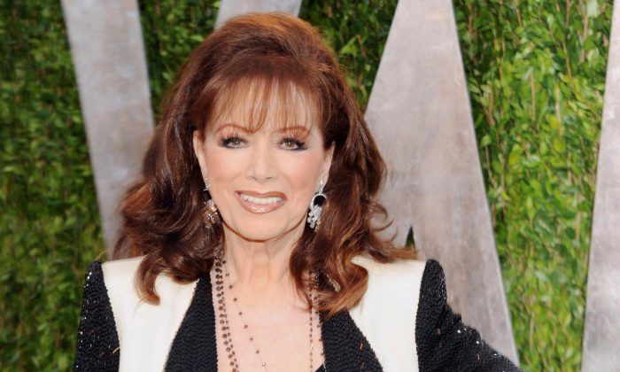 FILE - In this Feb. 24, 2013 file photo, author Jackie Collins arrives at the 2013 Vanity Fair Oscars Viewing and After Party in West Hollywood, Calif.  Collins, died in Los Angeles on Saturday, Sept. 19, 2015, of breast cancer. She was 77.  (Photo by Evan Agostini/Invision/AP, File)