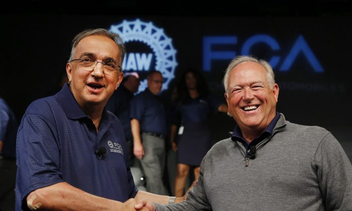 Fiat Chrysler Automobiles CEO Sergio Marchionne (L) and United Auto Workers President Dennis Williams shake hands during a ceremony to mark the opening of contract negotiations in Detroit on July 14, 2015. (AP Photo/Paul Sancya)