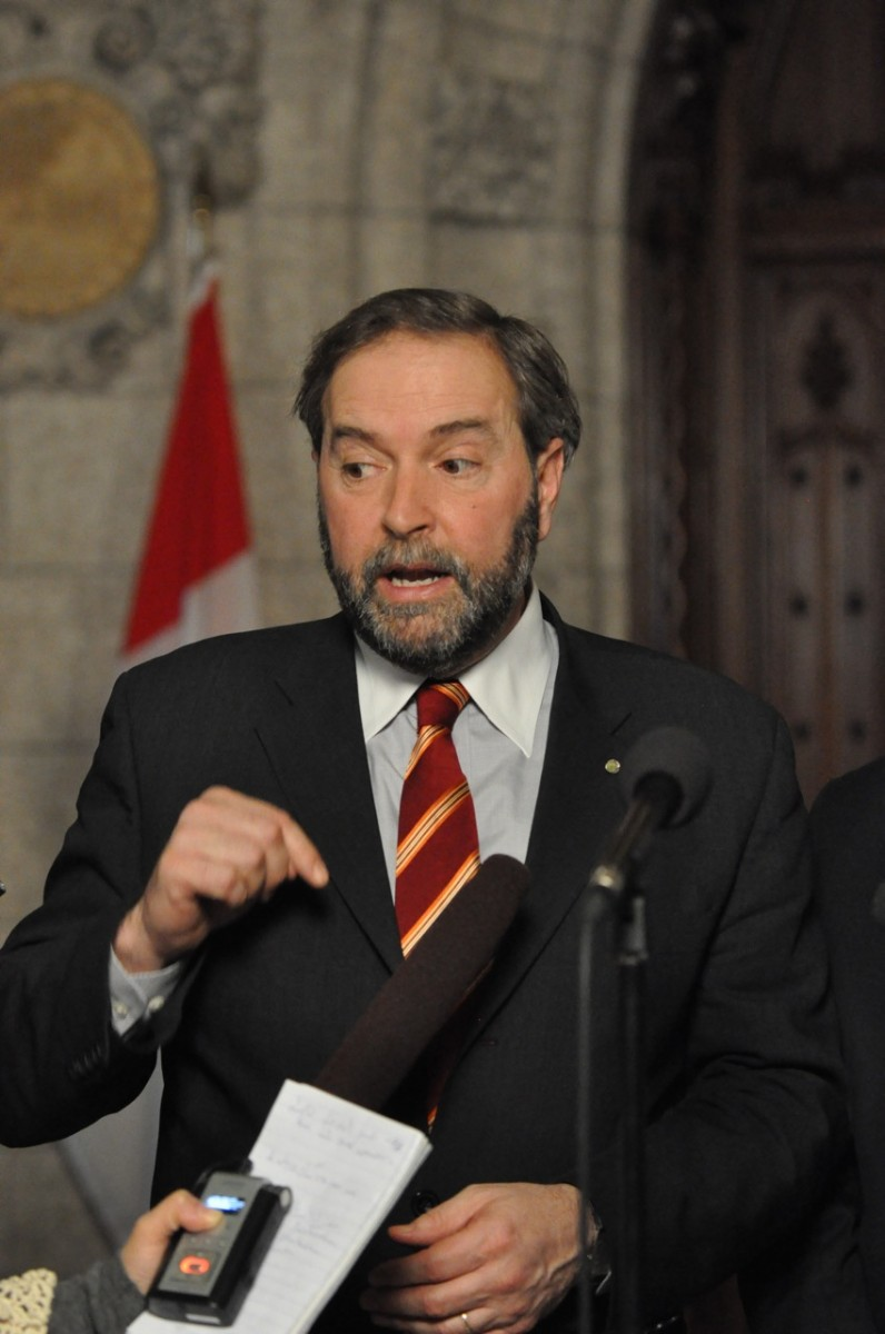 Thomas Mulcair, the perceived front-runner in the race to lead the New Democratic Party, speaks to reporters on Parliament Hill last year. (Matthew Little/The Epoch Times)