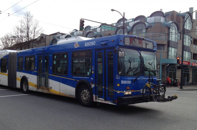 A TransLink bus travels along Broadway at MacDonald in Vancouver.