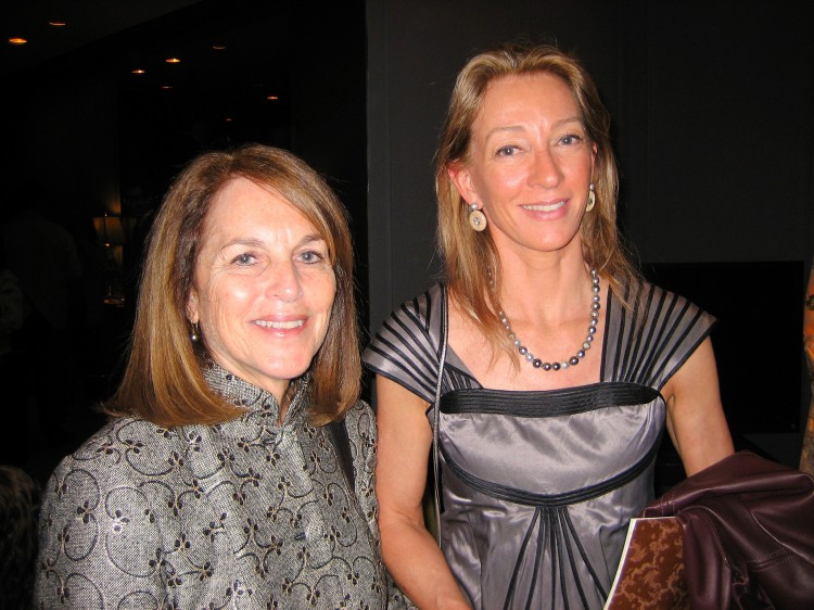 Cathy Tamraz (L), CEO of Business Wire, poses for a photograph with writer, Janet Crawford,