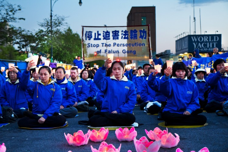 Falun Dafa practitioners hold a candlelight vigil as a peaceful protest near the Chinese Consulate in New York. The protest is against the Chinese Communist Party's 12-year persecution of the practice.