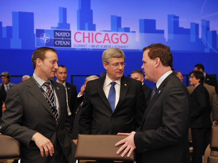 Prime Minister Stephen Harper speaks with Defence Minister Peter Mackay and Foreign Affairs Minister John Baird at the International Security Assistance Force meeting on Afghanistan during the NATO Summit in Chicago on Monday. (Mandel Ngan/AFP/Getty Images)