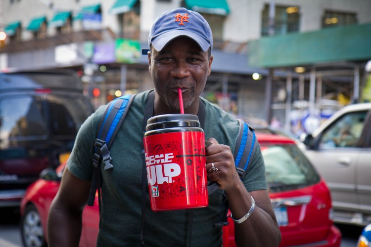 Eric Moor from Staten Island drinks an Extreme Gulp from 7-Eleven filled with Gatorade to protest Mayor Bloomberg's soda ban in Manhattan. (Benjamin Chasteen/The Epoch Times)