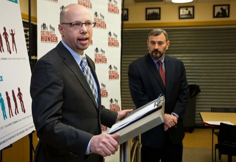 Stephen Grimaldi (L), executive director of Yorkville Common Pantry, and Joel Berg (R), New York City Coalition Against Hunger executive director, during a conference held by the coalition at Yorkville Common Pantry on in New York on Nov. 20, 2012. (Samira Bouaou/The Epoch Times)