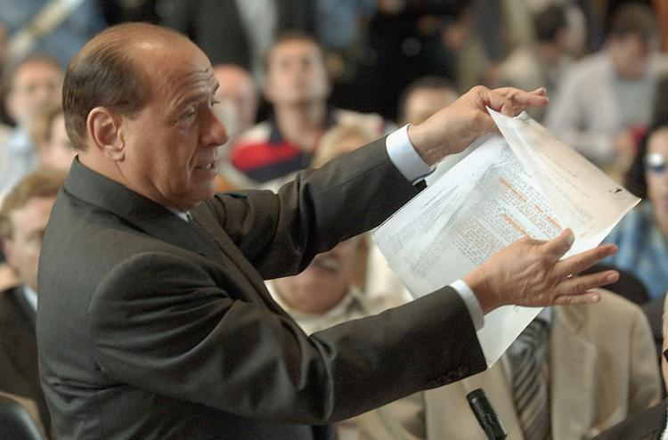 Italian Prime Minister Silvio Berlusconi addresses a courtroom on June 17, 2003 in Milan, Italy. Berlusconi was in tribunal to defend himself against corruption charges linked to his media company.  (Giuseppe Cacace/Getty Images)