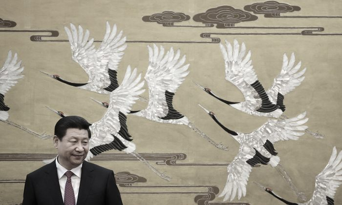 Chinese Communist Party leader Xi Jinping in the Great Hall of People on Sept. 16, 2013 in Beijing. (Feng Li/Getty Images)