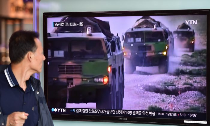 A man watches a news report at a railway station in Seoul on Sept. 15, 2015, on the confirmation from North Korea that the Yongbyon nuclear reactor seen as the country's main source of weapons-grade plutonium had resumed normal operations, raising a further red flag amid growing signs the North may be considering a long-range rocket launch next month in violation of U.N. resolutions. North Korea mothballed the Yongbyon reactor in 2007 under an aid-for-disarmament accord, but began renovating it after its last nuclear test in 2013. (Jung Yeon-je/AFP/Getty Images)