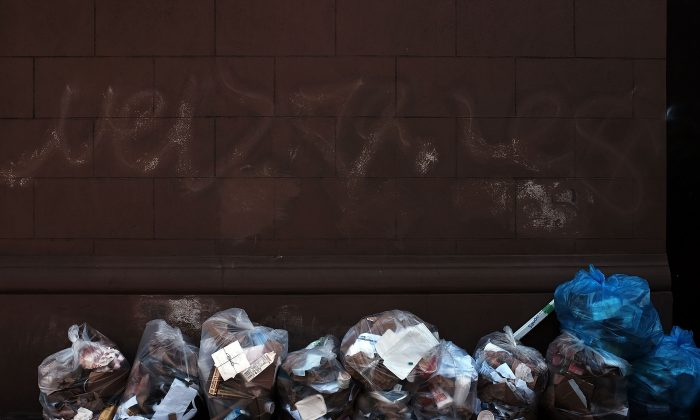 Bags of recycling are piled on a Manhattan street on April 22, 2015 in New York City. (Spencer Platt/Getty Images)
