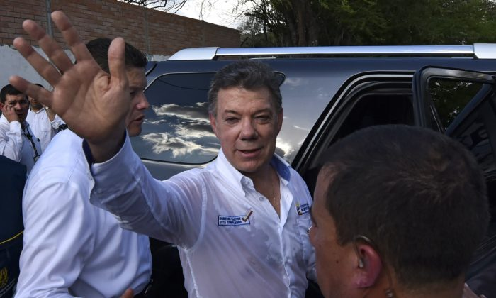 Colombian President Juan Manuel Santos waves during a visit to a shelter in Cucuta, Colombia on August 26, 2015. (Luis Acosta/AFP/Getty Images)