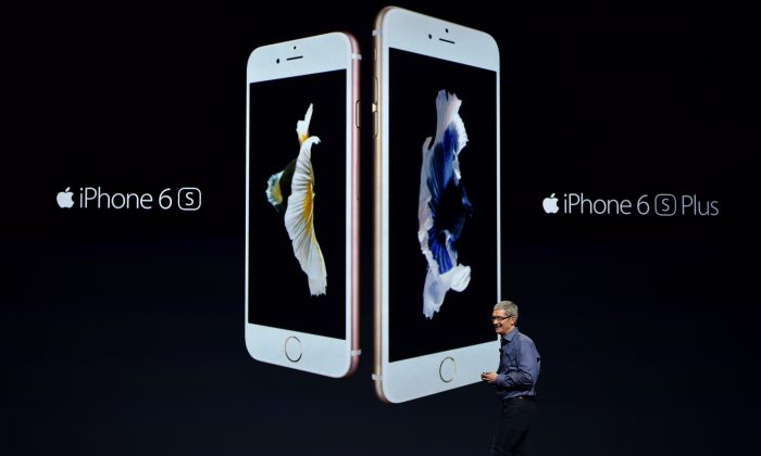 Apple CEO Tim Cook introduces the new iPhone 6s and 6s Plus during an Apple media event in San Francisco on Sept. 9. (Josh Edelson/AFP/Getty Images)