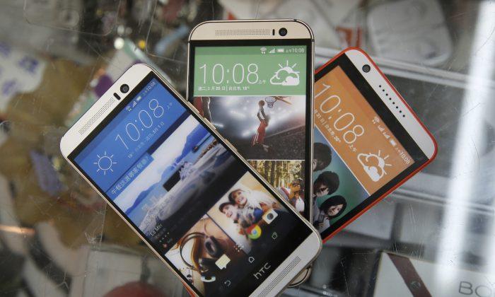 Used HTC smartphones on display in a phone shop in Taipei, Taiwan, on Sept. 21, 2015. (AP Photo/Wally Santana)