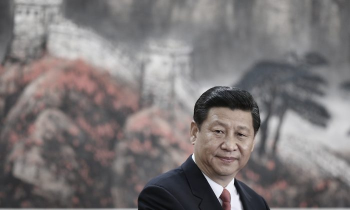 Xi Jinping greet the media at the Great Hall of the People on November 15, 2012 in Beijing, China. (Getty Images)
