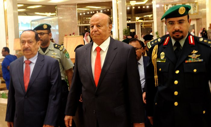 """Yemen's exiled President Abed Rabbo Mansour Hadi (C) arrives for the opening of """"Riyadh Conference for Saving Yemen and Building Federal State"""" in the Saudi capital Riyadh, on May 17, 2015. (Fayez Nureldine/AFP/Getty Images)"""