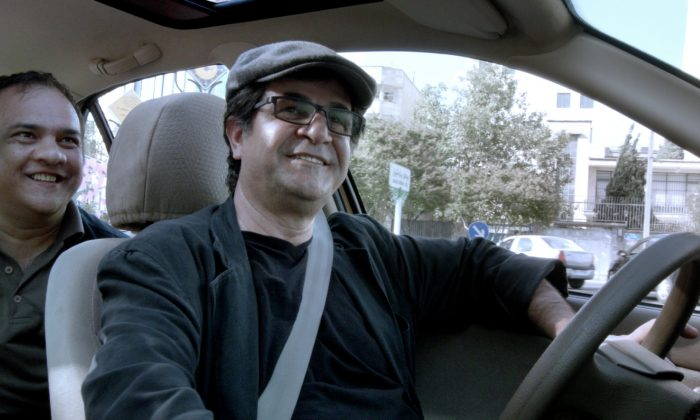 Jafar Panahi drives while talking to DVD smuggler Omid about their mutual love of cinema. (Courtesy of TIFF)