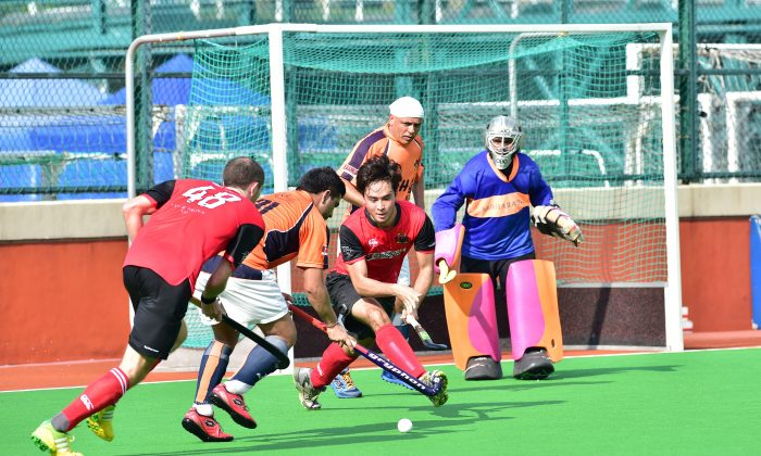 Valley-A on the attack against SSSC-A in their season opening Premier Division game at the HKFC ground on Sunday Sept 20, 2015. SSSC's (No 31) Aminder Dhessi steals the ball from Valley's James Page (48) and Max Parry, with goalie Gurdeep Singh and Satpal Singh watching progress. SSSC edged the evenly fought match 1-0. (Bill Cox/Epoch Times)