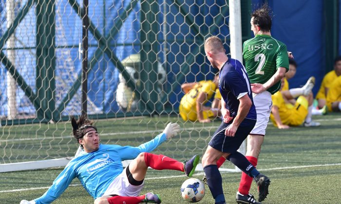 USRC goalkeeper Eugene Kan and Andy Mitchell defend against Wanderers during their nil-all draw at Sports Road on Sunday Sept 20, 2015. (Bill Cox/Epoch Times)