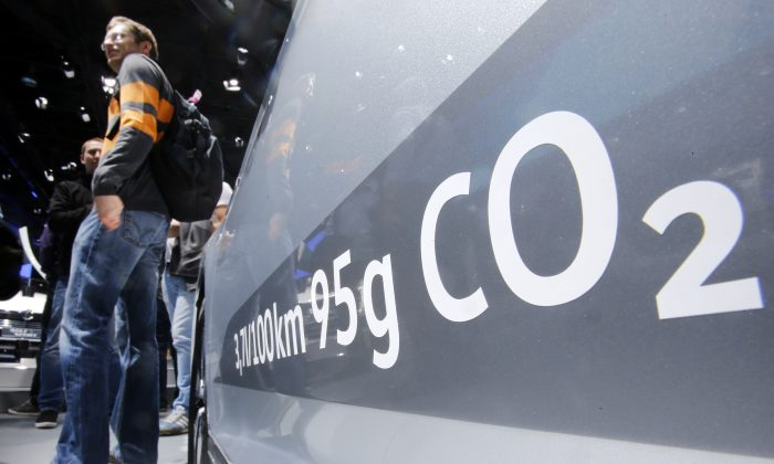 The amount of carbon dioxide emission is written on a Volkswagen Passat Diesel at the Frankfurt Car Show in Frankfurt, Germany, Tuesday, Sept. 22, 2015. (AP Photo/Michael Probst)