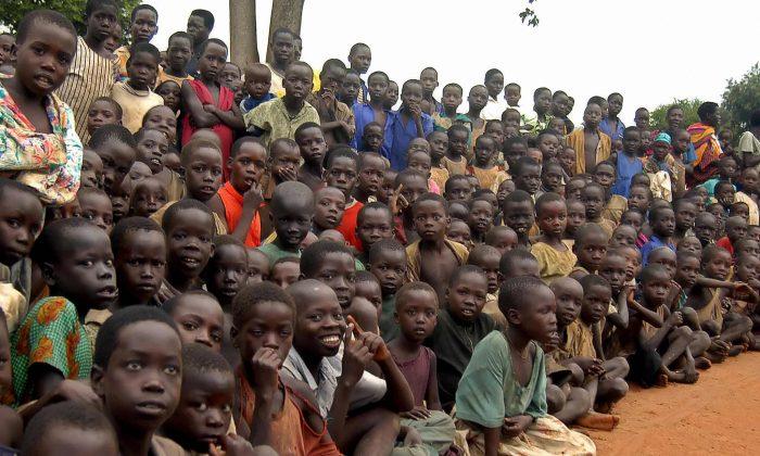Ugandan children at a refugee camp in nothern Uganda during a visit by the U.N. Humanitarian Co-ordinator John Holmes, on May 15, 2007. (Peter Busomoke/AFP/Getty Images)