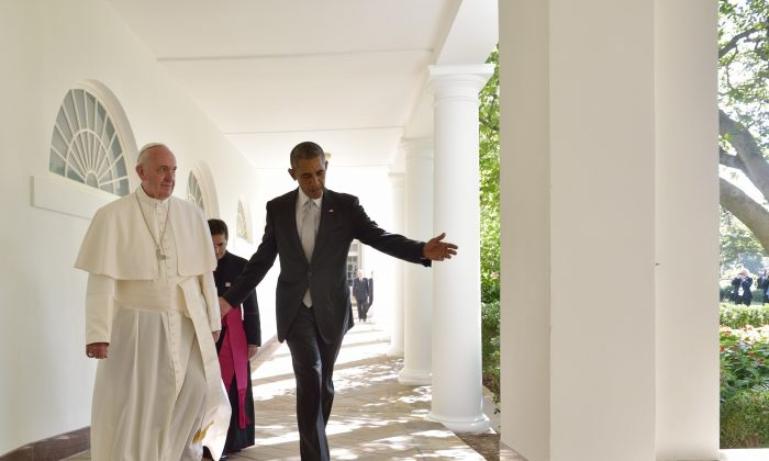 US President Barack Obama and Pope Francis walk through the Colonnade on their way to a bilateral meeting in the Oval Office of the White House on September 23, 2015 in Washington, DC. (Mandel Ngan/AFP/Getty Images)