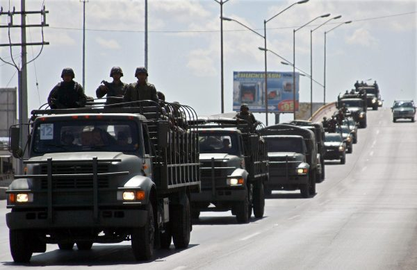 Members of Mexican Army arrive to Ciudad Juárez in northern Mexico, on March 13, 2009. Mexican President Felipe Calderon has acknowledged the country's drug war is bloodier and tougher than he thought when he first took office in 2006, but vowed to eradicate the 'cancer' that is consuming Mexico and has ordered the deployment of an additional 5,000 military troops and 1,000 policemen to the drug-ravaged northern border with the United States. (Jesus Alcazar/AFP/Getty Images)