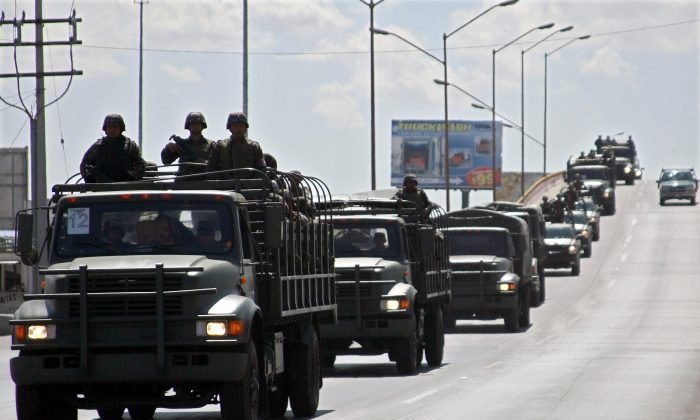 Members of Mexican Army arrive to Ciudad Juárez in northern Mexico, on March 13, 2009. (Jesus Alcazar/AFP/Getty Images)