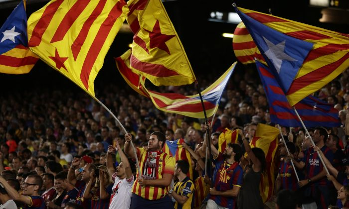 "In this photo taken Sunday, Sept. 20, 2015, FC Barcelona's supporters hold ""estelada flags, that symbolise Catalonia's independence, during a Spanish La Liga soccer match between FC Barcelona and Levante at the Camp Nou stadium in Barcelona, Spain. (AP Photo/Manu Fernandez)"