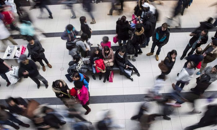 Shoppers make their way through the Eaton Centre in Toronto in this file photo. (The Canadian Press/Chris Young)