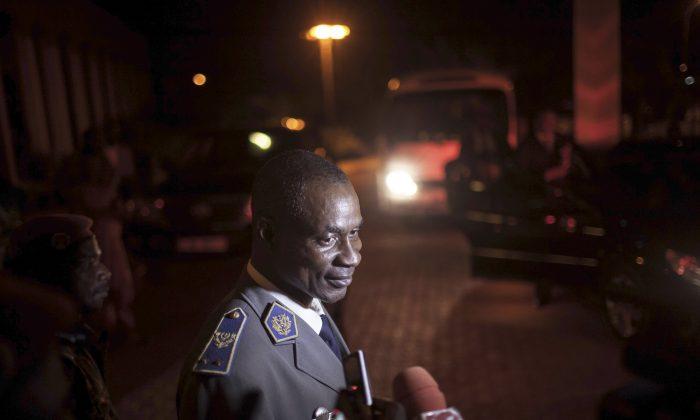 In this photo taken on Saturday, Sept. 19, 2015, Gen. Gilbert Diendere, who was named leader of Burkina Faso on Thursday, speak to media in Ouagadougou, Burkina Faso.   (AP Photo/Theo Renaut)