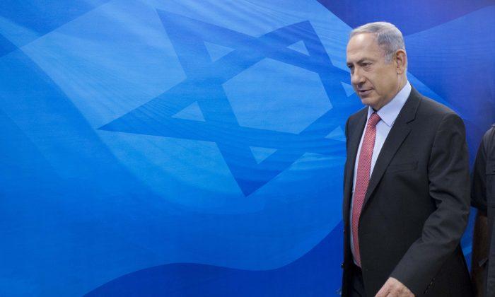 Israel's Prime Minister Benjamin Netanyahu arrives for the weekly cabinet meeting at his office, in Jerusalem. (Abir Sultan/Pool Photo via AP)