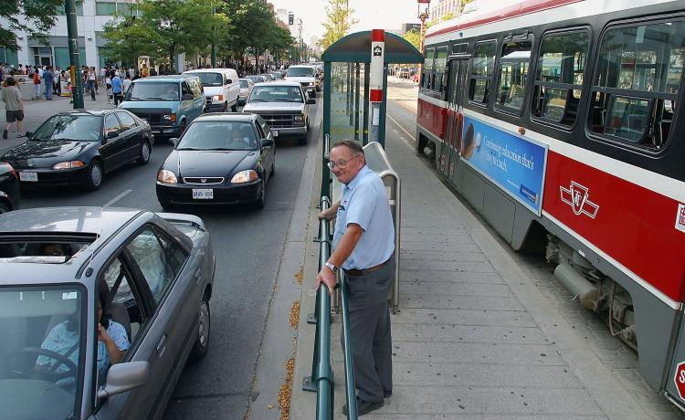 A Toronto Transit Commission street car driver stands by his streetcar. (Deborah Baic/Getty Images)