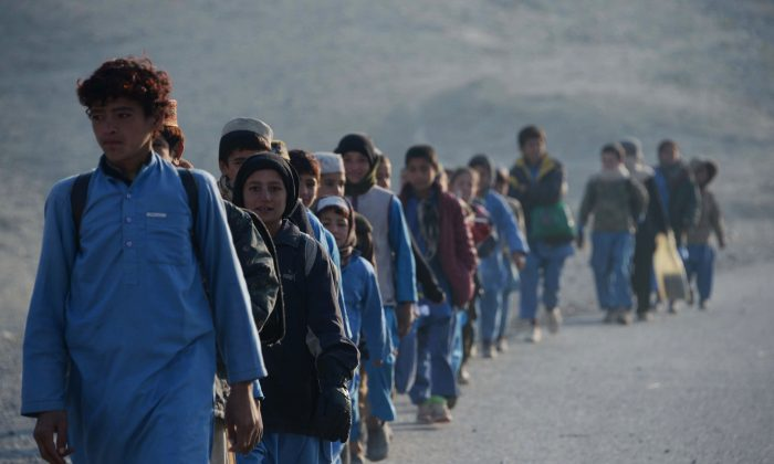Afghan schoolchildren leave after studying at an open-air classroom in the Mohmand Dara district in eastern Nangarhar Province, on Dec. 18, 2014. Afghanistan has had only rare moments of peace over the past 30 years, its education system undermined by the Soviet invasion of 1979, a civil war in the 1990s, and six years of Taliban rule. (Noorullah Shirzada/AFP/Getty Images)