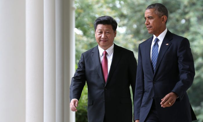 President Barack Obama (R) and Chinese President Xi Jinping (L) arrive for a joint press conference in the Rose Garden at the White House, in Washington, D.C., on Sept. 25, 2015. (Win McNamee/Getty Images)