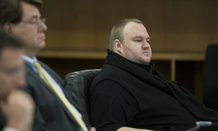 Kim Dotcom sits in the Auckland District Court during an extradition hearing in Auckland, New Zealand, on Sept. 21, 2015. The much-delayed extradition hearing for Doctom and three others who owned or helped run the website Megaupload began in Auckland this week in a case that could have broader implications for Internet copyright rules. (Jason Oxenham/New Zealand Herald via AP)