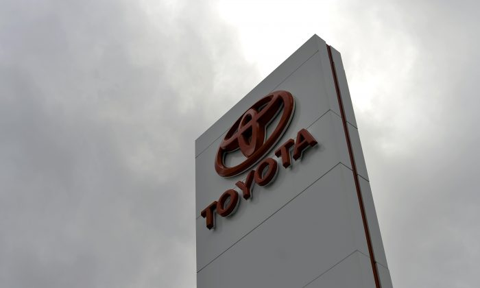 The Toyota logo on a sign outside a showroom in Sydney on February 11, 2014. (SAEED KHAN/AFP/Getty Images)